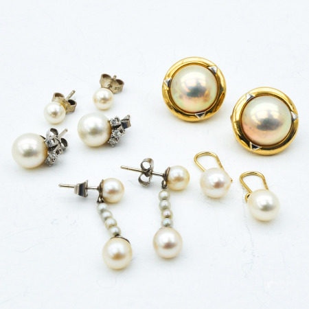 A Collection of 5 Pair of Earrings