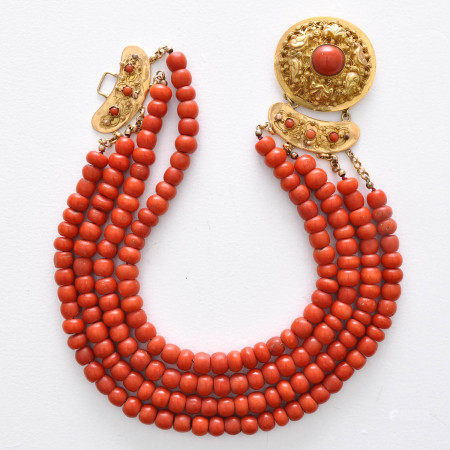 A 4 Strand Coral Necklace on Gold Clasp