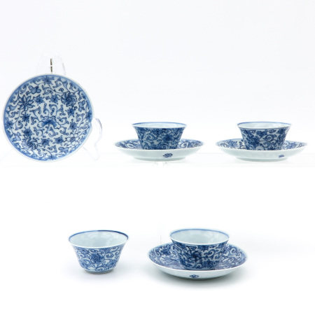 4 Blue and White Cups and Saucers