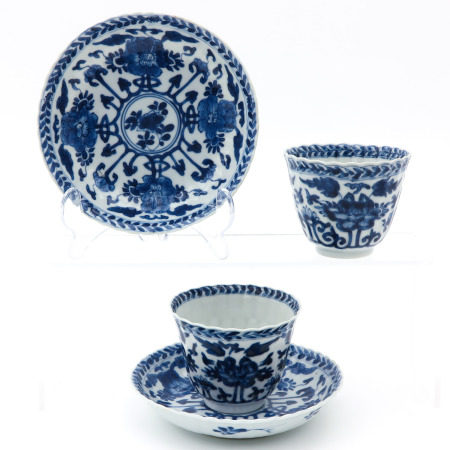 2 Blue and White Cups and Saucers