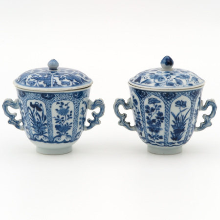 2 Blue and White Covered Cups