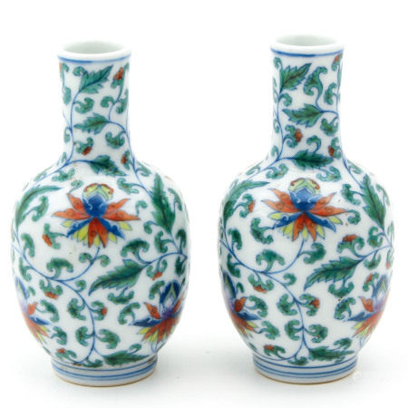 A Pair of Polychrome Small Vases