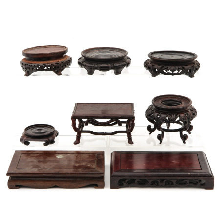 A Collection of Carved Wood Stands