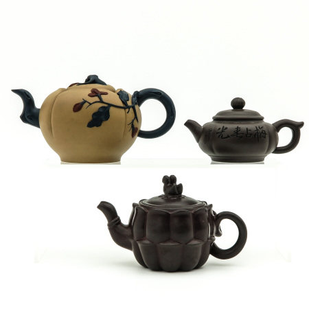 A Collection of 3 Yixing Teapots
