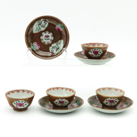 A Collection of 4 Cups and Saucers