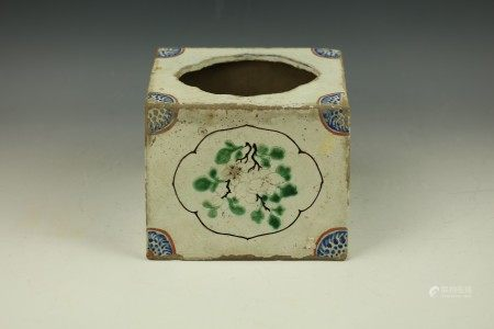 A Sloped Porcelain Pillow with Stylized Chinese Characters and Floral