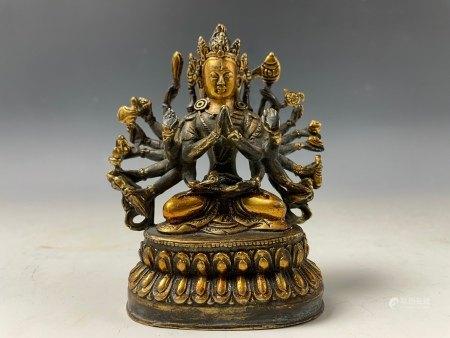 A Gilt Bronze Figure of Multiple Hands Buddha