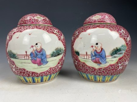 A Pair of Figural Crimson Ground Famille Rose Jars with Lids