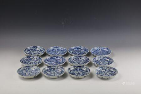 A Group of 12 Chinese Blue and White Lobed Dishes