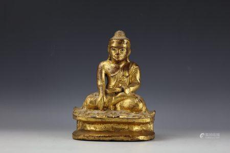 A Carved Southeastern Asian Gilt Bronze Buddha Figure