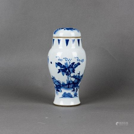 A BLUE AND WHITE 'FIGURAL' JAR AND COVER