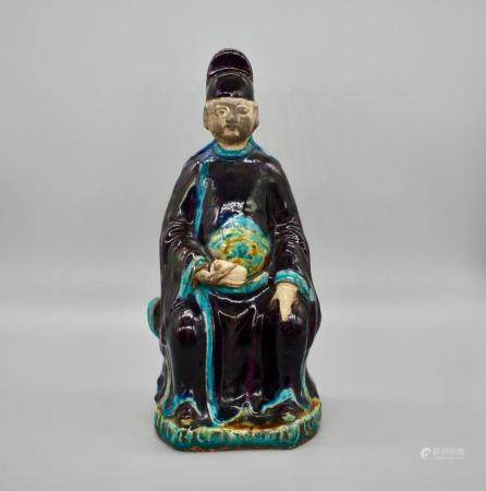 Chinese Aubergine and turquoise glazed seated official