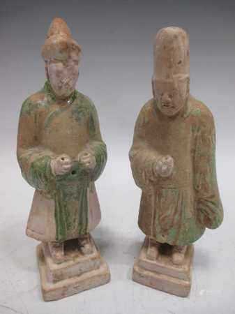 Two Chinese pottery figures, possibly Tang, each with remnants of green paint