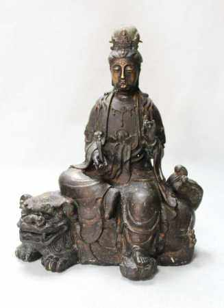 A Chinese bronze model of Guanyin,