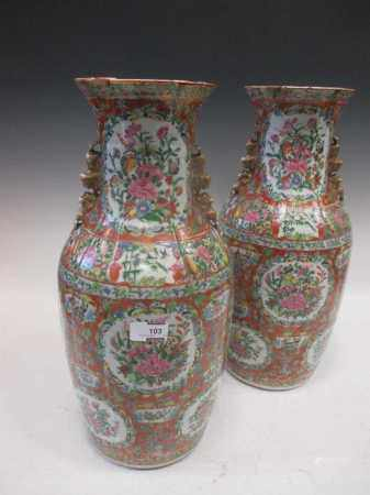 A pair of Chinese Canton vases c1860, Qing Dynasty, decorated with butterflies and flowers