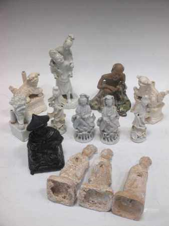 Various Chinese white glazed joss stick holders including a pair modelled as Foo Dogs; Chinese white