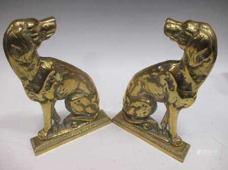 A pair of brass spaniel dog side profile door stops, 19th century, adapted from andirons, 32cm and