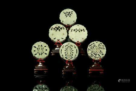 SIX CHINESE CIRCULAR JADE PLAQUES ON STANDS