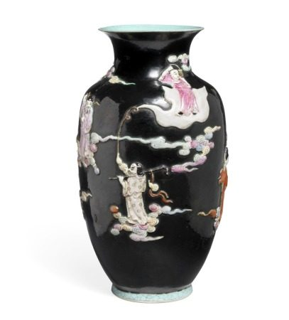 A Chinese famille noire baluster porcelain vase, moulded in relief depicting the Eight Immortals crossing the sea, supported by a low foot encircling a recessed base bearing Qianlong sealmark on turqouise ground. Late Qing-Republic period. H. 20 cm.        Provenance: Danish private collection based on two generations stay in China 1885–1945.