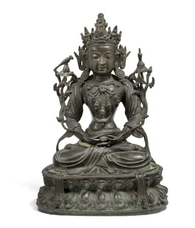 A Chinese bronze figure of Tara, seated in dhyanasana on a double-lotus throne with the hands in dhyana mudra. Her breast adorned with beaded jewellery, and shoulders flanked by lotus flowers adorned with bird and nectar vase. Ming 1368–1644. Weight 3046 g. H. 25 cm.       Provenance: Danish private collection.