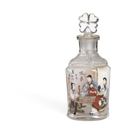 A Chinese glass snuffbottle, interior painted decoration with the fairy tale Dream of Fox. Inscribed Tang Zichuan. C. 1900. H. 11 cm.        Provenance: Engineer Rasmus Black 1871–1937, Sophus Black's elder brother, was employed by the Great Northern Telegraph Company and stationed in China 1898–1917.