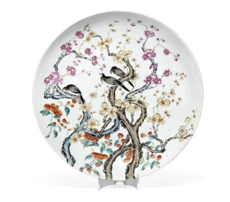 A Chinese enamelled porcelain dish painted with magpies on blooming branches continued on the reverse. Qianlong six-character mark, but Guangxu period 1875–1908. Diam. 46.5 cm.