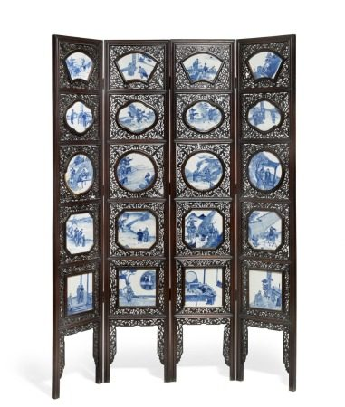 A Chinese four panel hardwood screen, frame carved and pierced with densely scrolling foliage and mounted with 20 porcelain plaques decorated in blue with motifs of Chinese historical and mythological heroes. C. 1900. H. 222 cm. W. 160 cm.       Provenance: Danish private collection.