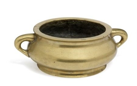 A Chinese bombé-shaped bronze censer with vertical loop handles and recessed foot rim. Xuande six-character mark, but 18th-19th century. Weight 4493 g. H. 10 cm. Diam. 23 cm.        Provenance: Danish private collection.