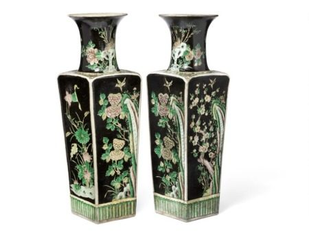 A pair of Chinese famille noire square tapering porcelain vases decorated in colours with birds perched amongst flowers. 19th century. H. 60 cm. (2)       Provenance: Danish collection, bought by owner and sent to Denmark from Asia c. 1960, thence by descent. Wooden boxes incl.