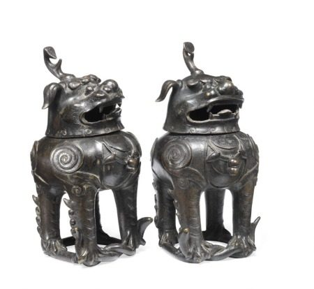 A pair of Chinese patinated bronze Luduan censers, each beast stands on an intertwined snake, flame like points and roundels on the body, seperate head, open mouth with fangs. Ming 1368–1644. Weight both 1795 g. H. 18 cm. (2)       Provenance: The Swedish city architect Salomon Sörensen, 1856–1937. Salomon Sörensen was Malmø's architect in the years 1893–1924. He collected Chinese and Japanese art most of his life.