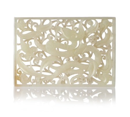 A CHINESE WHITE JADE OPENWORK DRAGON PLAQUE
