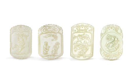 GROUP OF FOUR JADE PLAQUES