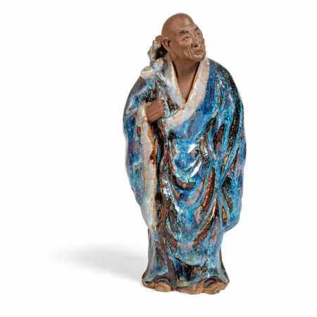 FLAMBE-GLAZED SHIWAN POTTERY FIGURE OF A MONK LATE QING DYNASTY-REPUBLIC PERIOD, 19TH-20TH CENTURY