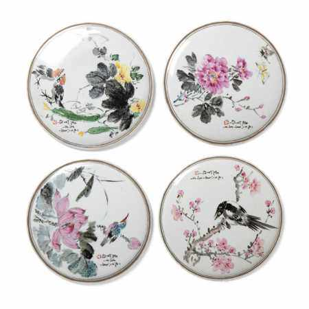 GROUP OF FOUR FAMILLE ROSE CIRCULAR PORCELAIN PLAQUES DATED TO 1967