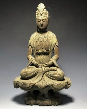 A WOODEN FIGURE OF GUANYIN