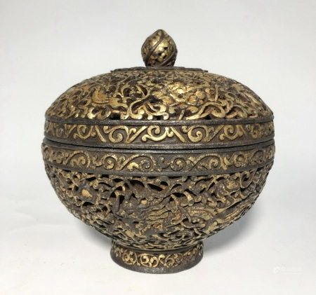 A GILT-IORN BOX AND COVER