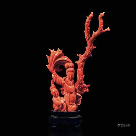 A carved red coral group, China, early 1900s