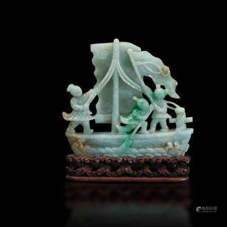 A carved jadeite group, China, early 1900s
