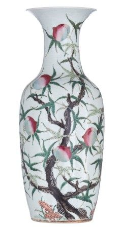 A Chinese famille rose 'Nine Peaches' vase, decorated with peach branches, at th