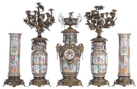 A Chinese Canton famille rose five piece mantle clock garniture , decorated with