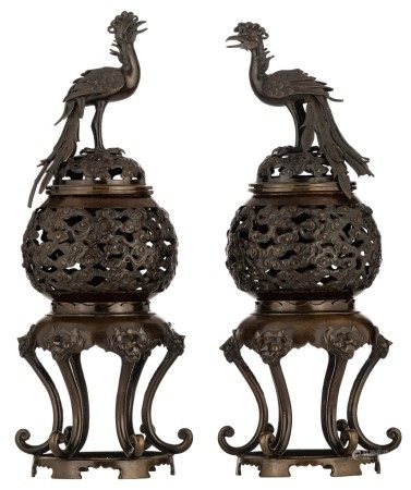 Two Indo-Chine bronze openwork censers, the pot decorated with scrolling clouds,