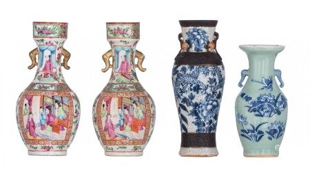Two Chinese Canton famille rose floral decorated vases, the panels with figures;