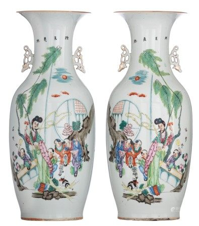 A pair of Chinese famille rose vases, decorated with a lady and playing children