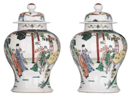 Two Chinese polychrome vases and covers, overall decorated with a mountainous la