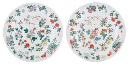 Two Chinese polychrome decorated plates, the center with flowers and insects, th