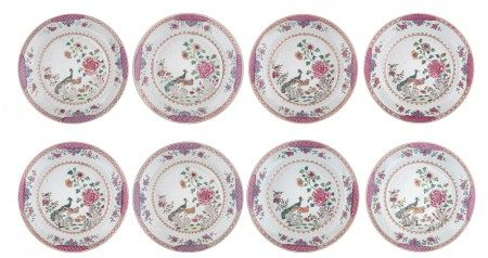 Eight Chinese famille rose 'Double Peacock' export dishes, decorated with a peac