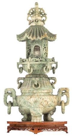 A Chinese temple shaped stone group, the legs dragon shaped, a stone seated Buda