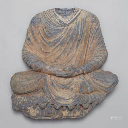 A Gandhara grey schist torso of Buddha Shakyamuni. Pakistan. 2nd/3rd century