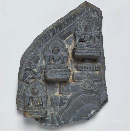 A Pala black stone fragment of a stele. Northeastern India, Bengal. 12th century