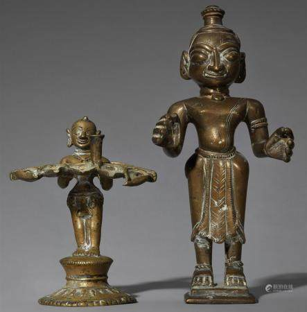 A Bengali brass male figure and an oil lamp. 19th/20th century
